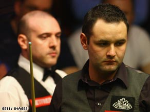 Stephen Maguire and Jamie Burnett playing against each other at the World Snooker Championships.