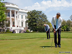 U.S. President Barack Obama and Vice President Joe Biden make use of the White House putting green.