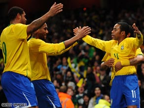 Robinho, right, is congratulated by Brazil team-mates after his magic unhinged Italy in the prestige friendly.