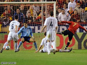 David Villa (far right) scores the opening goal in Spain's 2-0 victory over England in Seville.