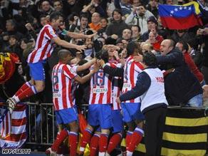Atletico players celebrate Aguero's winning goal in the Vicente Calderon stadium.