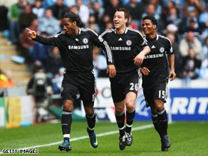 Didier Drogba (far left) celebrates his opening goal as Chelsea reached the FA Cup semifinals.