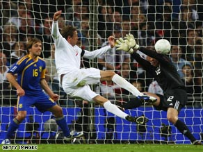 Crouch fires England into the lead at Wembley on his first start under coach Capello.
