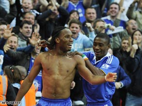 A bare-chested Drogba is congratulated by Salomon Kalou after scoring the winner at Wembley.
