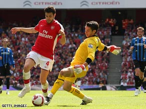 Cesc Fabregas rounds goalkeeper Brad Jones for Arsenal's second goal in their 2-0 victory over Middlesbrough.