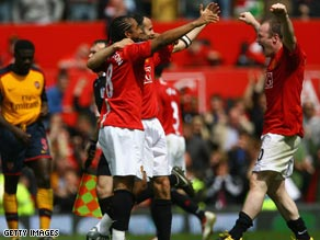 United players celebrate after securing the draw that gave them a third successive Premier League title.