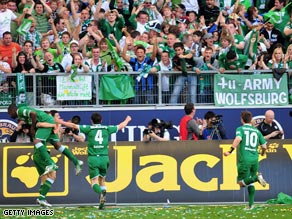Wolfsburg spark the club's first championship celebrations with a final-day thrashing of Werder Bremen.
