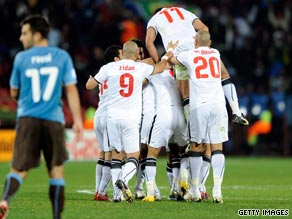 Egypt players celebrate Mohamed Homos' goal in their stunning 1-0 victory over world champions Italy.