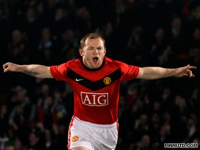 Manchester United striker Wayne Rooney sports the club's new kit for the forthcoming season