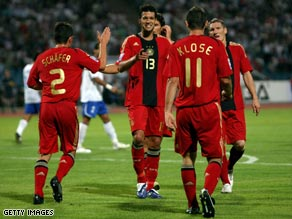 Germany celebrate Klose's goal in Baku which confirmed their victory.