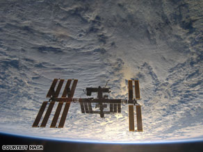 Debris passed close by the international space station Thursday, and its crew moved to an escape craft.