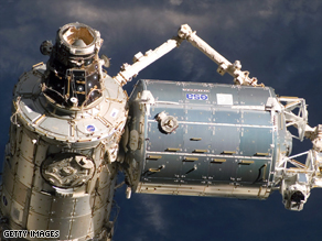 NASA says debris may threaten the International Space Station, seen here from Atlantis in February 2008.