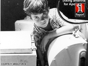 At age 10, Greg Force reaches his arm into a tiny hole to fix an antenna crucial to Apollo 11.