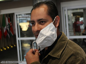 Alberto Morales wore a mask on his flight from Mexico City to Denver, Colorado, on Monday.