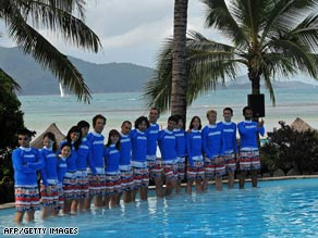 The 16 finalists for caretaking an island are shown on Sunday arriving at Hamilton Island.