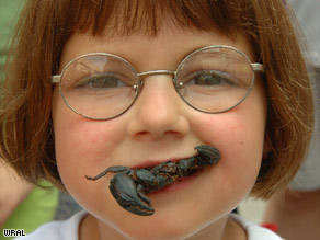 Unusual food festivals include BugFest in Raleigh, North Carolina, where a young visitor tries a stir-fried scorpion.