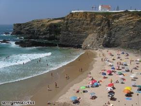 Sandy beaches dot Portugal's rugged coastline.
