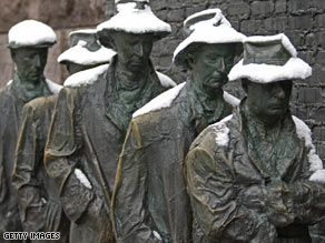 Life-sized statues of a Great Depression breadline greet visitors to FDR memorial in Washington.
