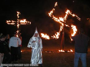 A cross and swastika are burned at an event called Hated and Proud in Nebraska in July 2008.