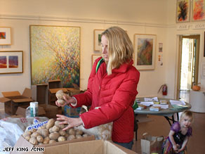 A California community center says it's seeing more working professionals visit its food bank.