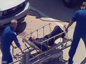 Boater Nick Schuyler, identified by WFLA-TV in Tampa, appears on a stretcher Monday after his rescue.