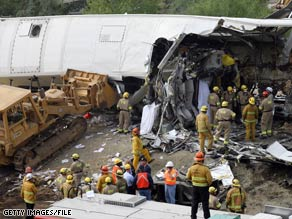 Firefighters and investigators inspect the wreckage a day after a train collision in California killed 25 people.