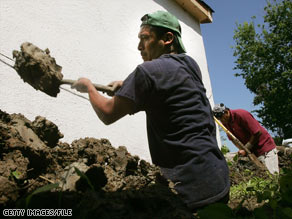 Migrant laborers help in the post-Hurricane Katrina cleanup in New Orleans, Louisiana, in 2006.