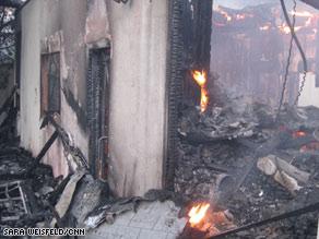 Fires rage Thursday through a Santa Barbara neighborhood, leaving a swath of destruction.