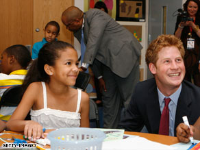 Prince Harry smiles whilte touring the Harlem Children's Zone on Saturday during a 36-hour visit to New York.