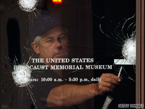 An FBI investigator looks over gunshot holes in the door of the U.S. Holocaust Museum on June 11.