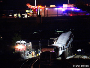Lights illuminate the wreckage as rescuers continue to work at the Metro crash site.