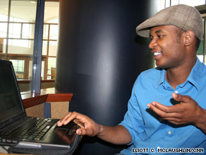 Chinedu Ezeamuzie shows some of his company's Web designs after an interview last week.