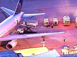 The diverted airliner sits on the tarmac at Miami International Airport.