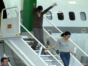 Laura Ling, left, and Euna Lee step off a plane Wednesday morning at the Bob Hope Airport in Burbank.