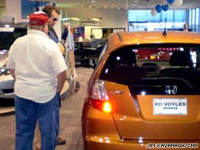 Car shoppers browse a Honda showroom Saturday morning in Marietta, Georgia.