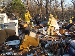 Rescue personnel search for potential trapped victims Wednesday in Lone Grove, Oklahoma.