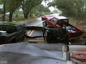 Vehicles jam a buckled road in Mobile, Alabama, Saturday after heavy rains.