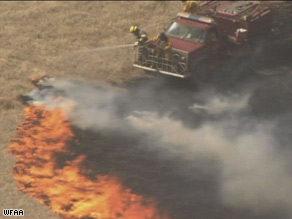 Firefighters in Bowie, Texas, try to get a grass fire under control. Bowie is about 70 miles northwest of Fort Worth.