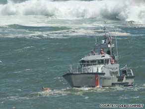 A U.S. Coast Guard rescue boat reaches a man swept out to sea Sunday at Acadia National Park in Maine.