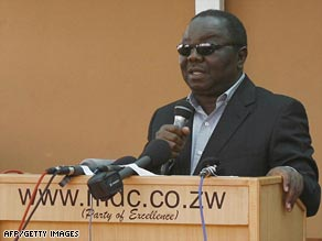 Morgan Tsvangirai addresses mourners Monday at his house in Harare soon after his return from Botswana.