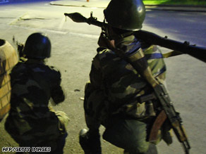 Soldiers are shown taking positions on the streets of Madagascar's capital, Antananarivo, on Monday night.