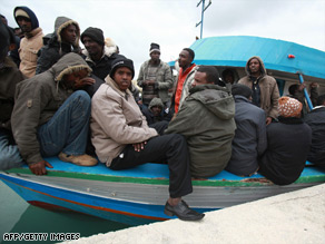 A group of 227 migrants sits on a fishing vessel in Malta last month after arriving from Somalia.