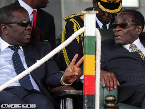 Zimbabwean Prime Minister Morgan Tsvangirai, left, with President Robert Mugabe.