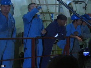 The crew of the Maersk Alabama exchange some words with media after the ship docked in Mombasa, Kenya.