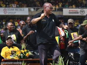 ANC leader Jacob Zuma and Nelson Mandela, seated, share a stage at a rally in Johannesburg on Sunday