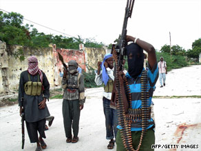 Islamist insurgents patrol part of Mogadishu during clashes with government forces.