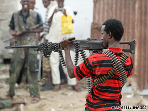 A Somali rebel points a heavy machine gun in the direction of government forces July 3.