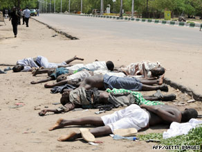 Bodies of hard-line Islamic rebels killed in battle lie in a Nigerian city. Civilians and troops have also died.