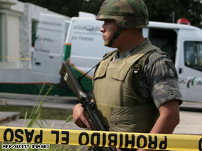 A soldier stands guard outside the forensics service headquarters in Cancun, Mexico, in February.