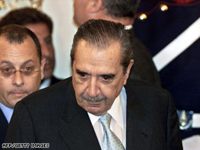 Alfonsin, right, arrives at the house of government in Buenos Aires in January 2002.